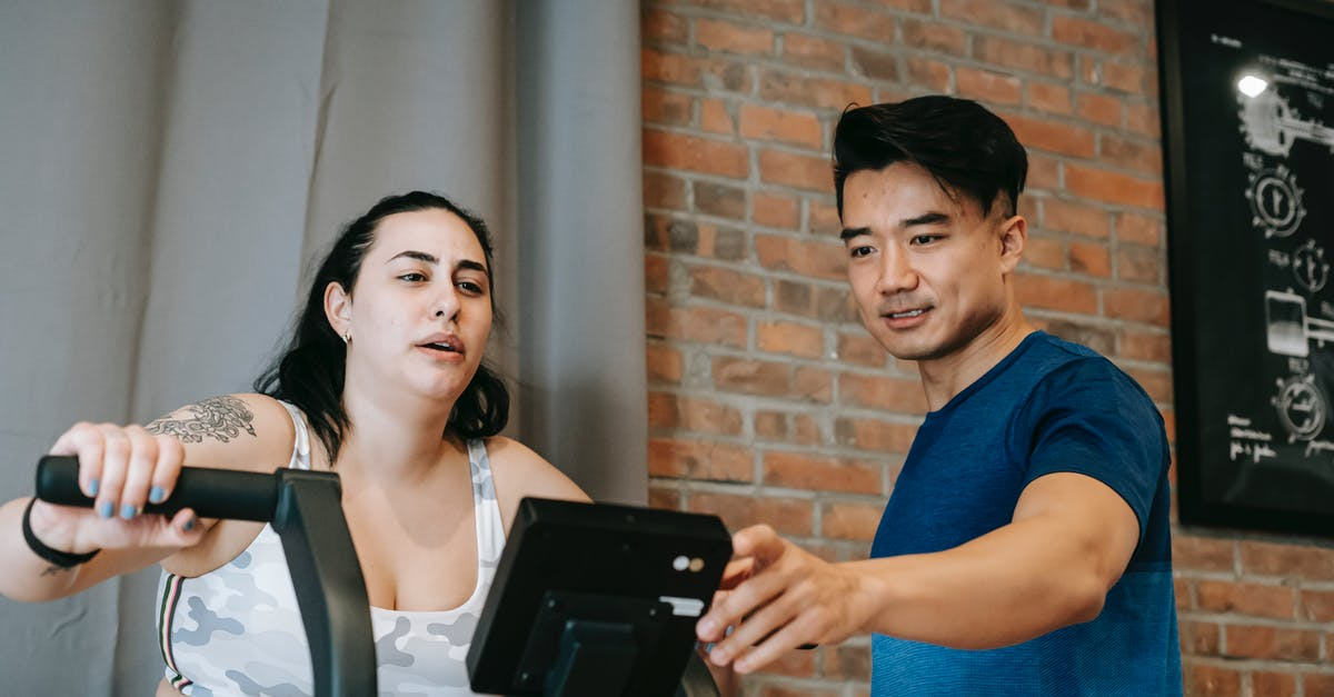 A man and a woman holding a phone